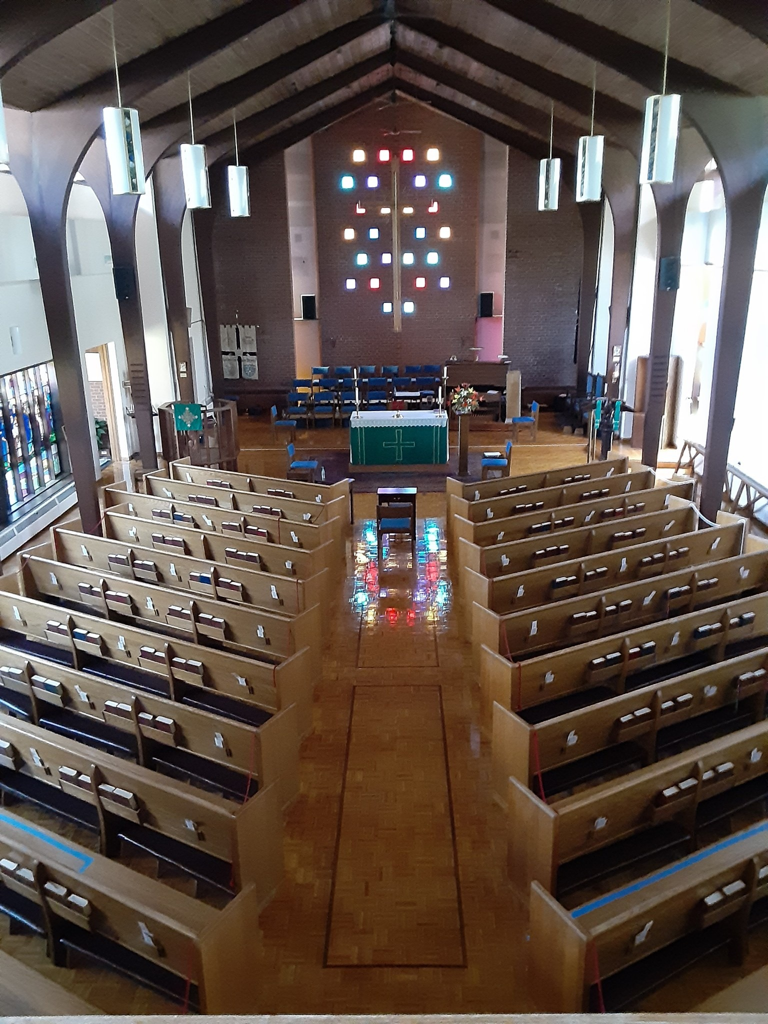 Nave and stained glass reflection